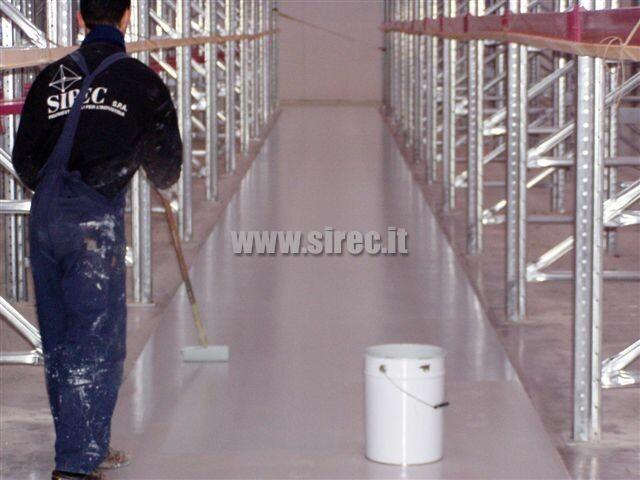 pavimento corsie strette magazzino trialaterali - DIN 15185 » Rettifica e correzione planarità pavimentazione di magazzino intensivo