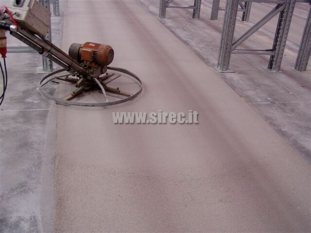 smoothing - compacting epoxy screed after correcting of flatness